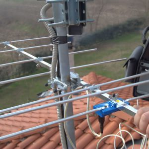 aerial installer tidying aerial cables